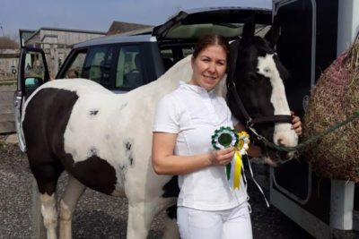 jennyrosettes 400x267 - Horse Jack Does College Proud at Dressage Competition