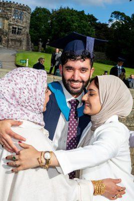 Student celebrating with family members 267x400 - Craven College celebrates its graduates' success alt